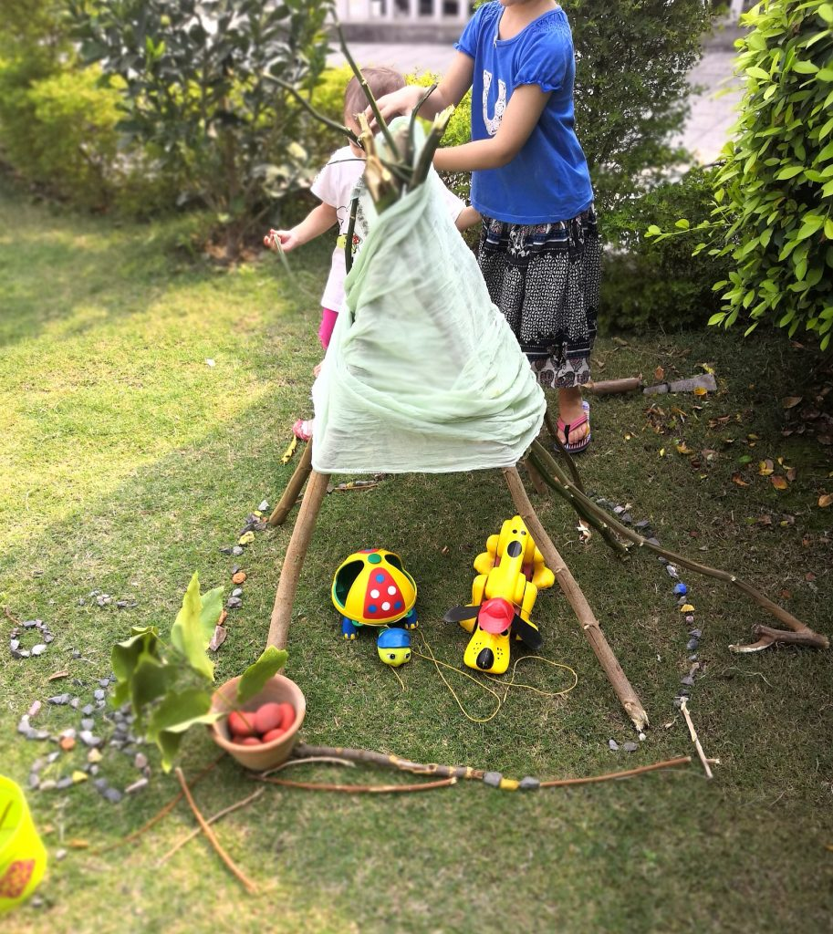 build a teepee-loose parts