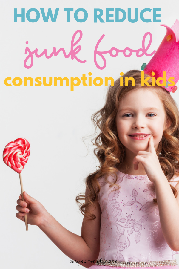 junk food kids-girl holding lollipop