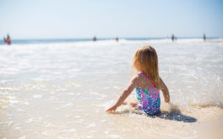 baby -girl-on-the-beach-best sunscreen for babies