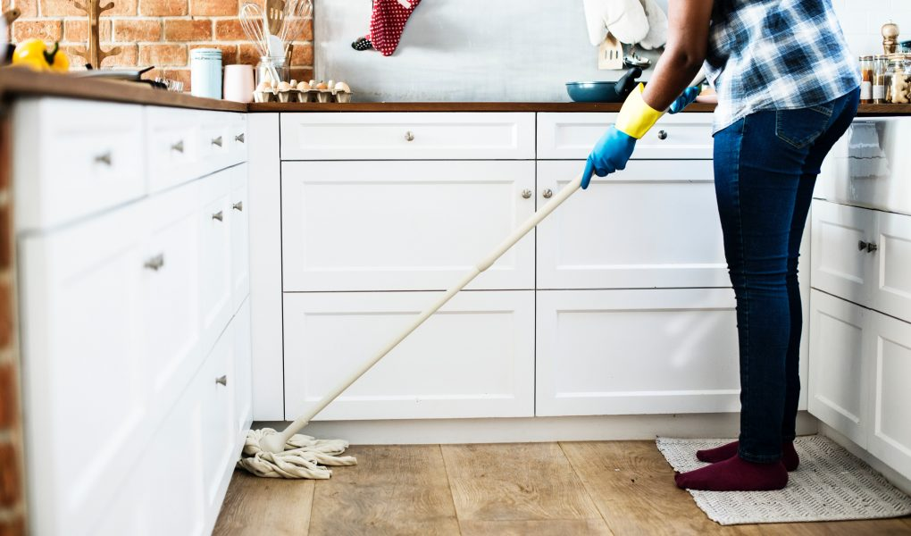 eco friendly home cleaning products - lady mopping floor